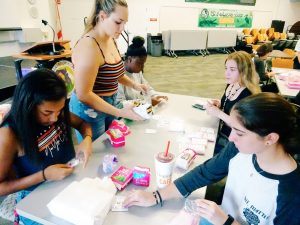 What it was like to pack 700 #HelpHER feminine products!